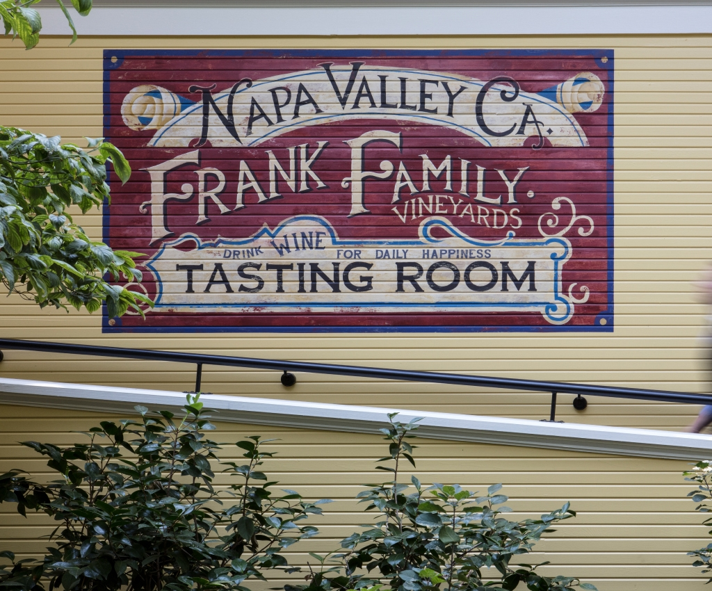 Handpainted Frank Family Vineyards sign on side of building