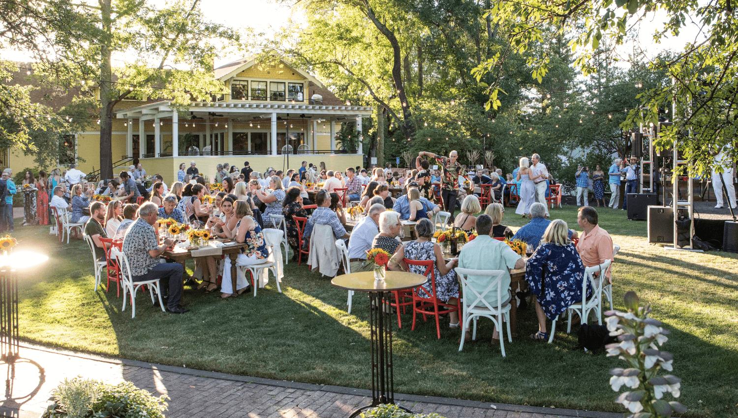 An early evening dinner with dancing and a band in the Member's Lawn
